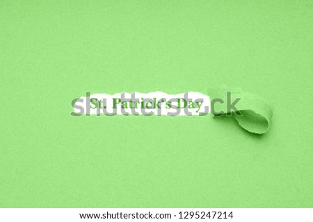 St. Patrick's Day is celebrated on March 17 - the irish national holiday is also known as Paddy's Day in Ireland - green paper background
