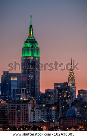 St Patrick's Day postcard. Empire State Building lit up in green for St Patrick's Day in New York City stock photo