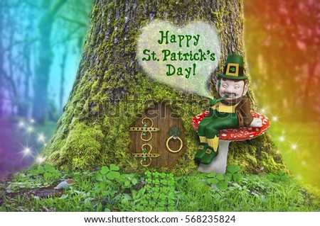 St. Patrick's Day text with Leprechaun sitting on a mushroom in front of a tree with a fairy door, rainbow and fairy sparks of light/St. Patrick's Day leprechaun on a mushroom in forest with rainbow #568235824
