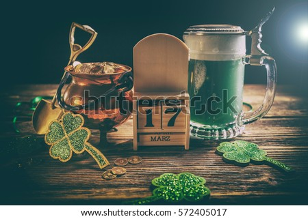 St. Patricks Day decoations with gold coins, green beer and shamrocks