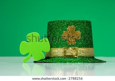 St. Patricks Day Decorations including a  green  leprechaun hat and a four leaf clover