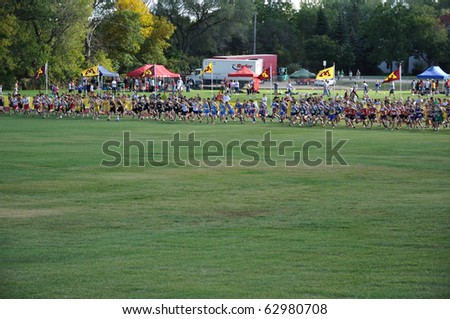 ST. PAUL, MN - SEPTEMBER 26 : The start of the Roy Griak Invitational Cross Country Meet with teams from numerous Minnesota high schools participating on September 26, 2009 in St. Paul, MN