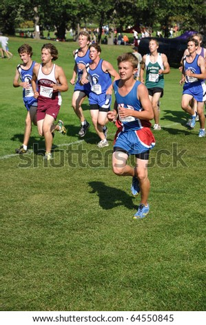 ST. PAUL, MN - SEPTEMBER 26 : Unidentified runners from many Minnesota high schools competing in the Roy Griak Invitational Cross Country Meet on September 26, 2009 in St. Paul, MN