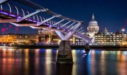 St Paul's Cathedral and Millennium Bridge over the River Thames in London