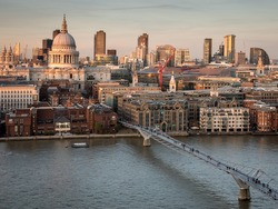 St. Paul's Cathedral and the City of London skyline. High angle view over the River Thames, London, with the skyline dominated by the dome of St. Paul's Cathedral at dusk.