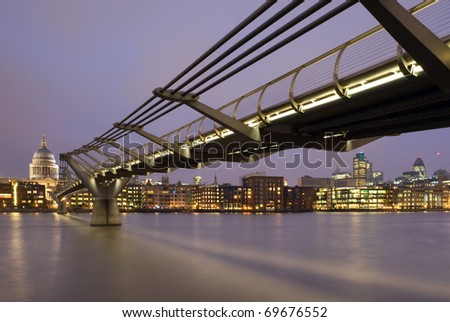 St. Paul's Cathedral and the Millennium Bridge at night in London, England.