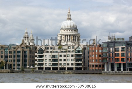 St Paul's Cathedral from the River Thames View from a boat on the River Thames in London, of St Paul's Cathedral behind rows of apartments and offices in the City of London.