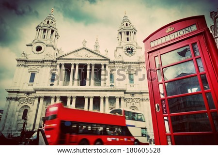 St Paul's Cathedral in London the UK Red bus and telephone booth cloudy sky Symbols of London in vintage retro style