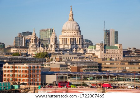 St Paul's Cathedral with Blackfriars traffic and railway bridges in London