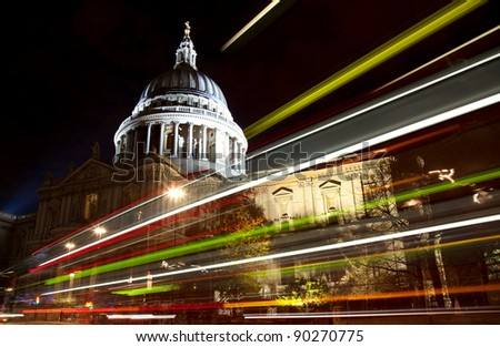 St Paul's cathedral with blurred bus trail at night