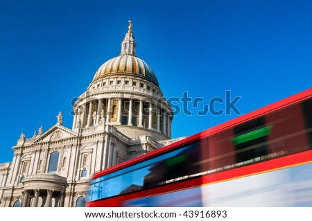 St. Pauls cathedral with motion blured double decker bus.