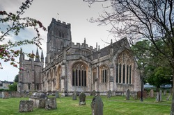 St Peter and St Pauls Church and its graveyard with tombs in Northleach town, Gloucestershire, Cotswolds, England - United Kingdom