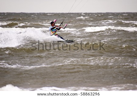 ST. PETER-ORDING, GERMANY - JULY 24: Professional kite-surfer Gunnar Biniasch, Germany, demonstrating his ability on the Palmolive Kitesurf Worldcup 2010, July 24, 2010 in St. Peter-Ording, Germany
