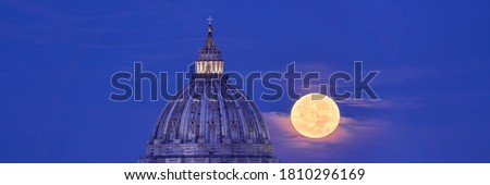 Photo of  St Peter's Basilica Dome with Full Moon in the Background. Real View of the Moon Actually Passing Behind the Vatican in Rome. Easy to Crop for Editorial, Commercial, Personal Use