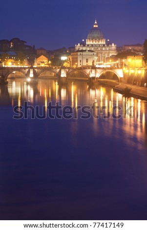 St Peter's Basilica in Rome, Italy, by night  - Tiber river on foreground