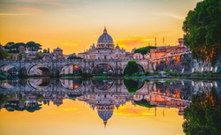 St. Peter's basilica in Rome,Vatican, the dome at sunset with reflection