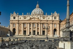 St. Peter's Square in the Vatican full of chairs for the faithful with the facade of the newly restored basilica
