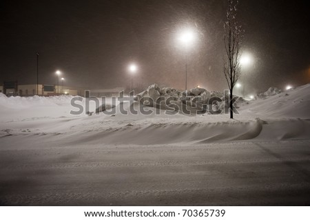 ST. PETERS, MO UNITED STATES FEBRUARY 2, 2011 - Snow continues to fall upon recently plowed parking lots during the blizzard that blanketed the U.S. Midwest.