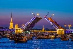 St. Petersburg in the evening. Russia. Bridges Of Petersburg. Rivers Of St. Petersburg. Divorced Palace bridge. People watch the bridge from the water. Pleasure boats on the Neva. Symbol Of Petersburg