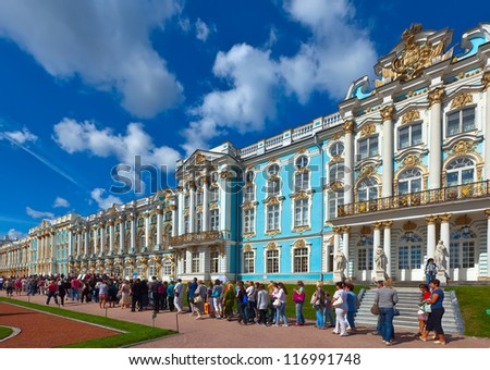 ST.PETERSBURG, RUSSIA - AUGUST 2: Catherine Palace in August 2, 2012 in St.Petersburg, Russia. Building is laid in 1717.  Now a museum. People are standing in line at Catherine Palace interior