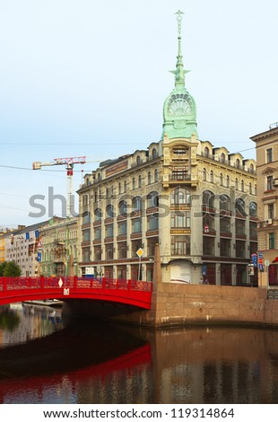 ST.PETERSBURG, RUSSIA - AUGUST 1: Red Bridge through Moyka River in August 1, 2012 in St.Petersburg, Russia. Bridge was designed and built in 1808-1813 to design by W. Heste and was rebuilt in 1953