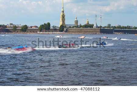 ST.PETERSBURG, RUSSIA - AUGUST 09: Speed boats on water on line on Neva at Formula 1 Powerboat World Championship race on August 09, 2009 in St.Petersburg, Russia.
