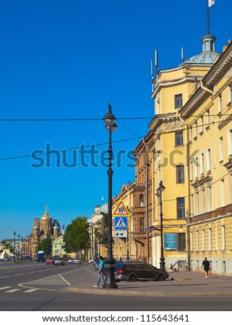 ST.PETERSBURG, RUSSIA - AUGUST 3: Street at Vasilyevsky Island in August 3, 2012 in St.Petersburg, Russia. Buildings of island began in mid 1710's. Now the district population of over 200 000 people