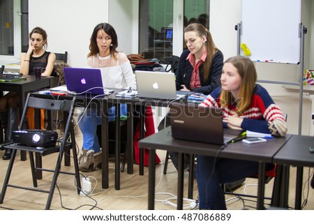 ST. PETERSBURG, RUSSIA - CIRCA MARCH, 2015: People are on workshop of drawing with pen on pads. Women students are on illustrations lesson #487086889