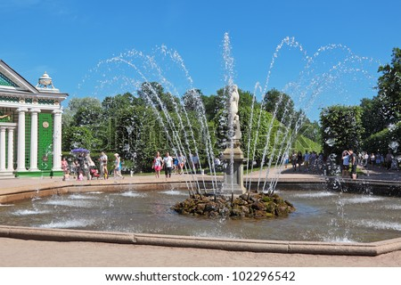 ST. PETERSBURG, RUSSIA - JULY 02: Tourists visiting the sights of the lower park of Peterhof (after the solemn opening of the fountains) on July 02, 2011 in St. Petersburg, Russia.