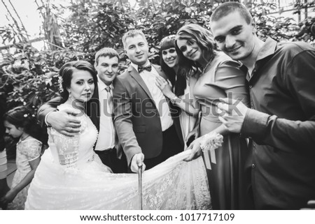 ST PETERSBURG, RUSSIA - JULY 22, 2017: Wedding Event. Bride with Friends on a Wedding Walk in Greenhouse #1017717109