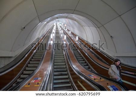 St. Petersburg, Russia - March 20, 2017: Metro escalator during the minimum transport load. #620795699
