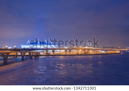 ST. PETERSBURG, RUSSIA - MARCH, 2019:  The Neva River flows into the Gulf of Finland. High-speed highway. Stadium Zenit Arena. Cities of Russia. Bridges of Petersburg #1342711301