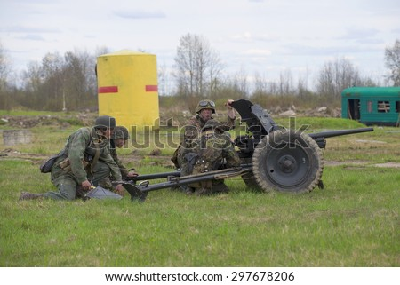 ST. PETERSBURG, RUSSIA - MAY 05, 2015: German gunners with anti-tank gun. Reconstruction of the episode of the Great Patriotic War