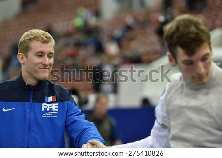 ST. PETERSBURG, RUSSIA - MAY 3, 2015: Julien Mertine of France handshakes with German athlete after the team quarterfinal of International fencing tournament St. Petersburg Foil, stage of World Cup
