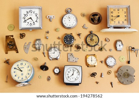 ST.PETERSBURG, RUSSIA -  17 May 2014: Retro alarm clocks, watches and parts for mechanical watches (Soviet alarm clocks and watches brands Zaria, Slava, ZIM, Zvezda and  Swiss watch HY MOSER)
