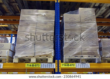 St. Petersburg, Russia - November 21, 2008: Pallets with foodstuffs stand on a rack shelf goods warehouse.