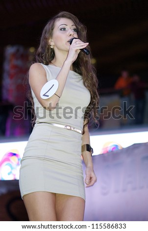 ST. PETERSBURG, RUSSIA - OCTOBER 13: Brunette girl sings during final stage of the contest Russian Beauty on October 13, 2012, in St.Petersburg, Russia