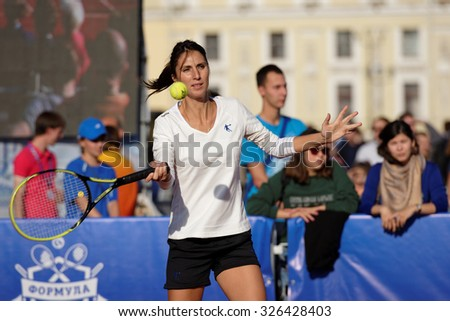 ST. PETERSBURG, RUSSIA - SEPTEMBER 12, 2015: Former professional tennis player Anastasia Myskina in the exhibition match of St. Petersburg Open. The match included in the program of City\'s Tennis Day.