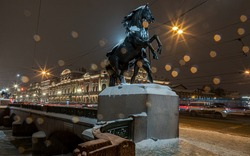 St. Petersburg. Snowfall. Equestrian sculpture on Anichkov Bridge over Fontanka River. Made in the 19th century. Inscription on bridge: Passage of ships prohibited. Open space. Common property