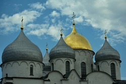 St. Sophia Cathedral, an 11th century Orthodox church in the city of Veliky Novgorod, Russia against the background of a blue sky with clouds on a summer day. Cathedral domes