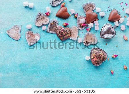 St Valentine's heart shaped decorations, chocolates and sweets on pheasant blue background. Top View #561763105