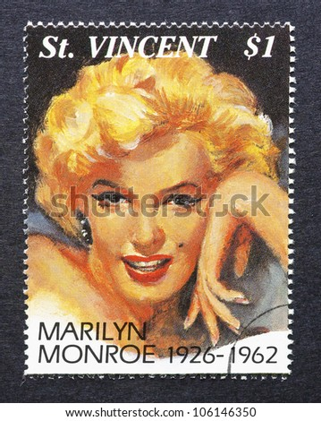 ST. VINCENT - CIRCA 1994: a postage stamp printed in St. Vincent showing an image of Marilyn Monroe, circa 1994. - stock photo