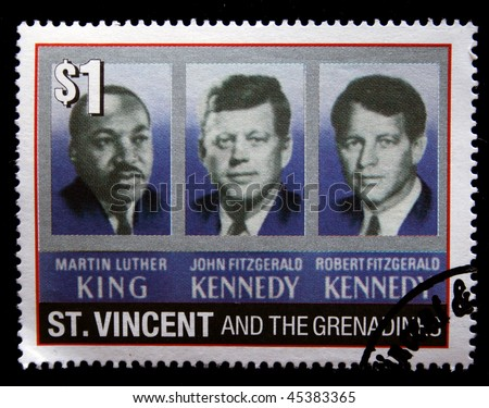ST. VINCENT - CIRCA 1970s: A stamp printed in St. Vincent shows image of Martin Luther King, John Fitzgerald Kennedy and Robert Fitzgerald Kennedy, circa 1970s - stock photo
