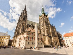 St. Vitus Cathedral at Prague Castle in Prague under Clear Blue Sky Sunny Summer. Full of Tourist people