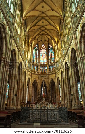 St. Vitus cathedral in Prague, interior image in low light.