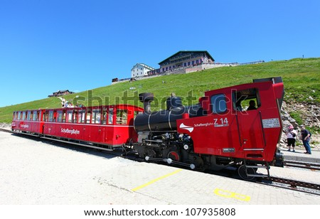 ST. WOLFGANG, AUSTRIA - JULY 8: Unidentified people enjoy vintage cogwheel railway at Schafberg Peak (1783m) This track is steepest railway in Austria on July 8, 2012 in St. Wolfgang.