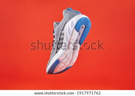 Stability and cushion running shoes. New unbranded running sneaker or trainer on orange background. Men's sport footwear. Pair of sport shoes. Stock fotó ©