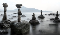 Stability nature meditation background. Calm water and stone balance zen tower. Nature photography