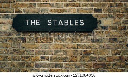 Stables sign indicating