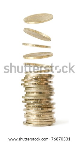 stack  and coins falling from above isolated on white